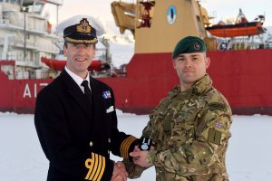 Captain Rhett Hatcher presents Lance Corporal Leon Brunning with his Long Service and Good Conduct medal.