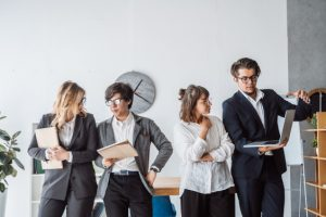 business-people-standing-office-discuss_1153-4048